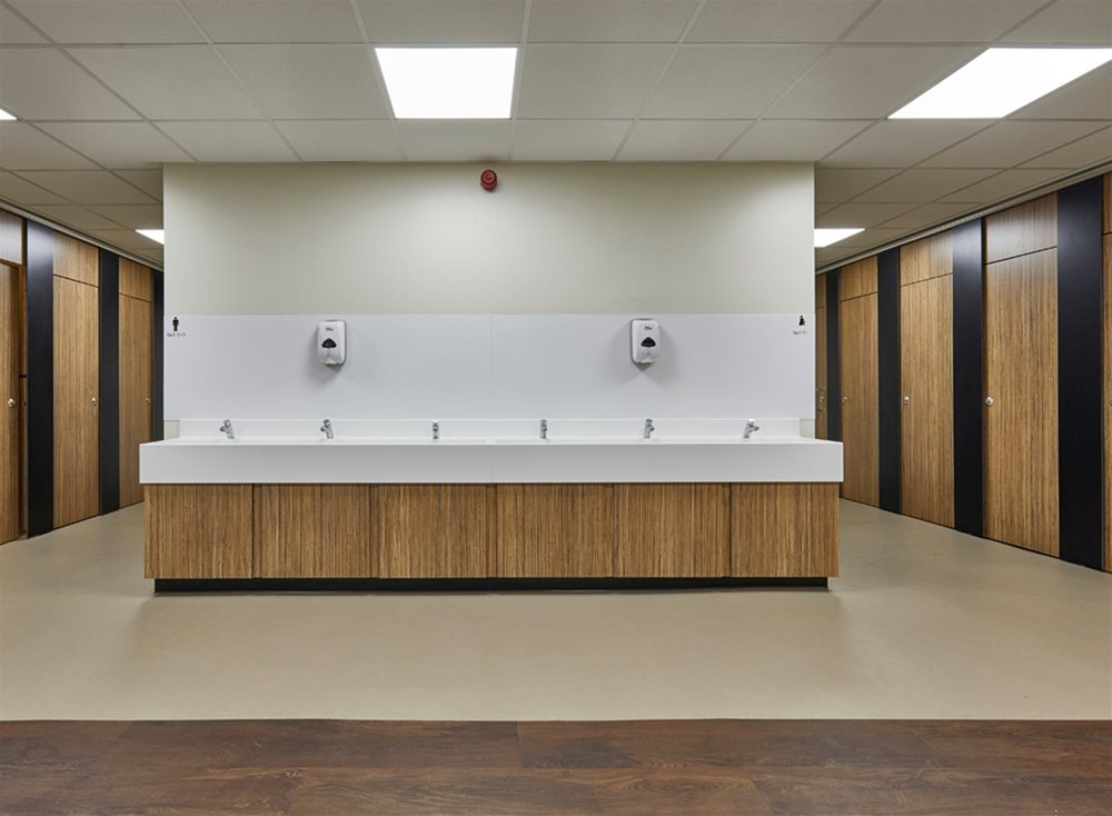 Dunhams Washrooms case study using Arpa Athlon Zebrano Naturale from Performance Panels Ltd
